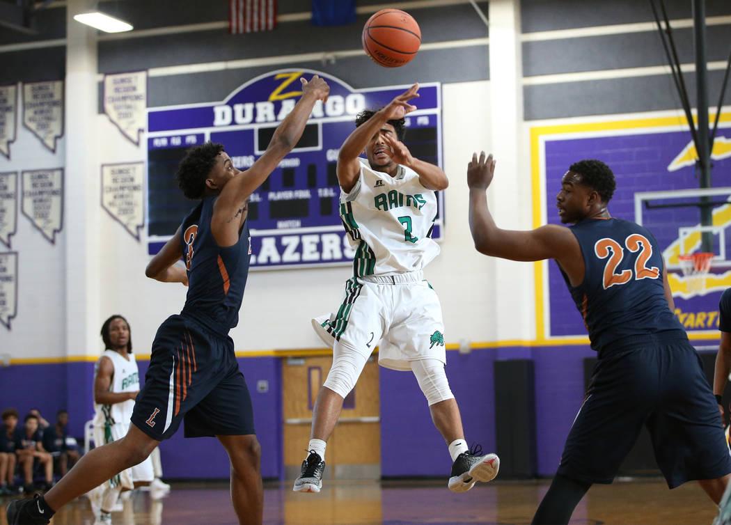 Rancho's James Brown (2) makes a pass against Legacy in the boy's basketball game at Durango High School in Las Vegas, Saturday, Jan. 13, 2018. Erik Verduzco Las Vegas Review-Journal @Erik_Verduzco