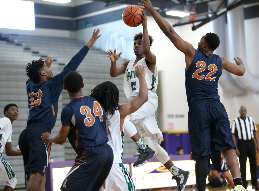 Rancho's Devan Wright (5) goes up for a shot against Legacy in the boy's basketball game at Durango High School in Las Vegas, Saturday, Jan. 13, 2018. Erik Verduzco Las Vegas Review-Journal @Erik_ ...