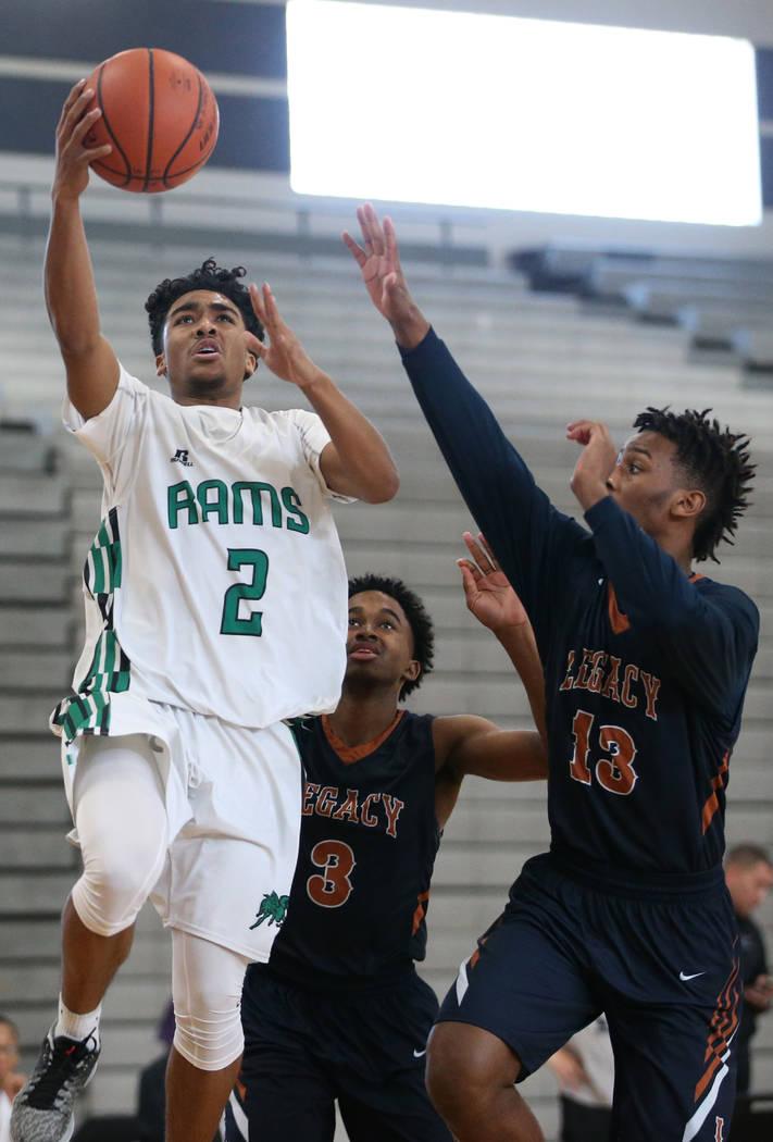 Rancho's James Brown (2) goes up for a shot against Legacy in the boy's basketball game at Durango High School in Las Vegas, Saturday, Jan. 13, 2018. Erik Verduzco Las Vegas Review-Journal @Erik_V ...