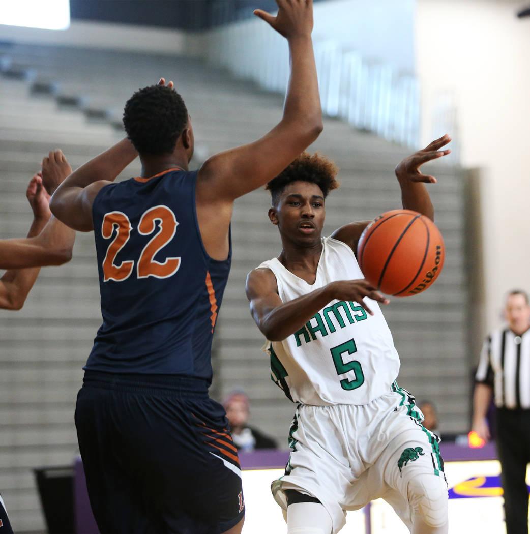 Rancho's Devan Wright (5) makes a pass against Legacy in the boy's basketball game at Durango High School in Las Vegas, Saturday, Jan. 13, 2018. Erik Verduzco Las Vegas Review-Journal @Erik_Verduzco
