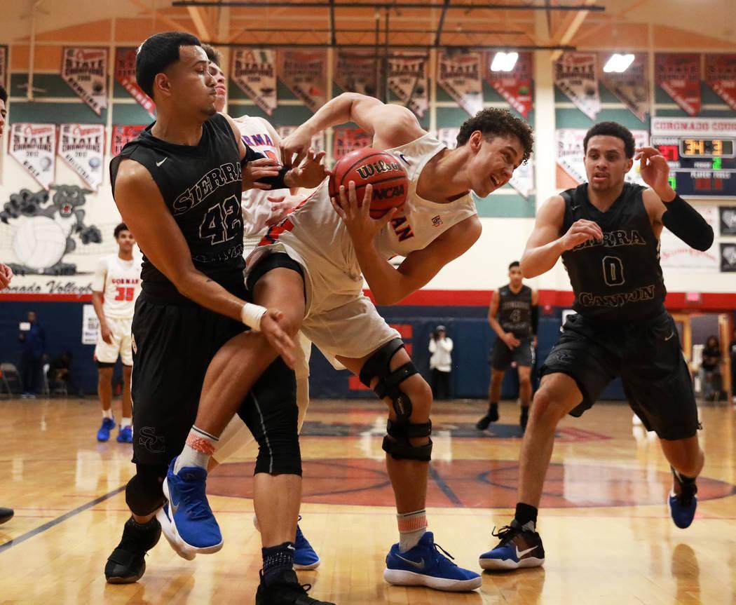 Bishop Gorman's Saxton Howard defends the ball from Sierra Canyon in the boys basketball game at Coronado High School in Las Vegas, Jan. 15, 2018. Bishop Gorman won 82-80. Andrea Cornejo Las Vegas ...