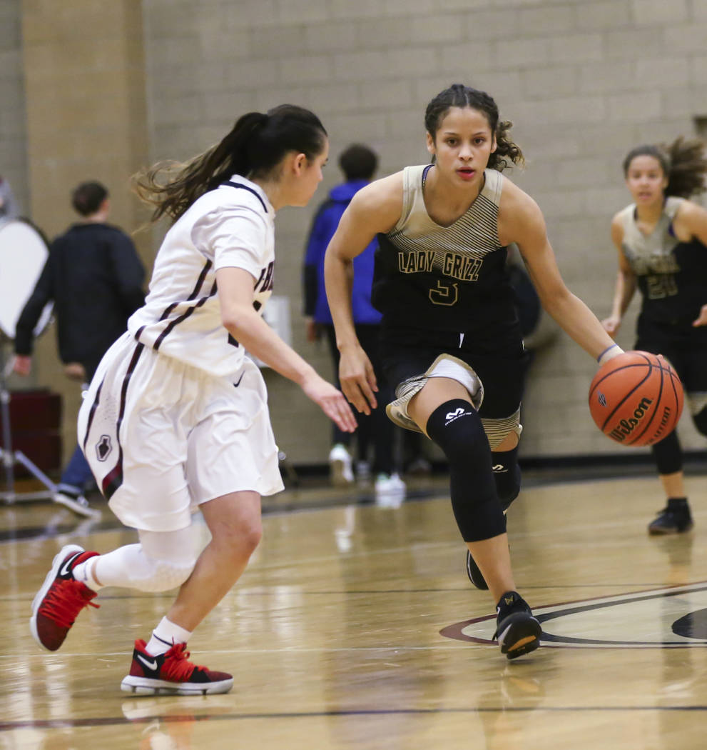 Spring Valley's Essence Booker (3) moves the ball past Desert Oasis' Brianna Clark (4) during a basketball game at Desert Oasis High School in Las Vegas on Tuesday, Jan. 16, 2018. Chase Stevens La ...