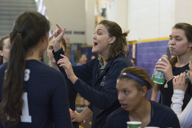 Shadow Ridge's Coach Karissa Guthrie, center, speaks with her team during a match against Durango at a Sunset Region girls volleyball semifinal match at Durango in Las Vegas, Thursday, Nov. 3, 201 ...