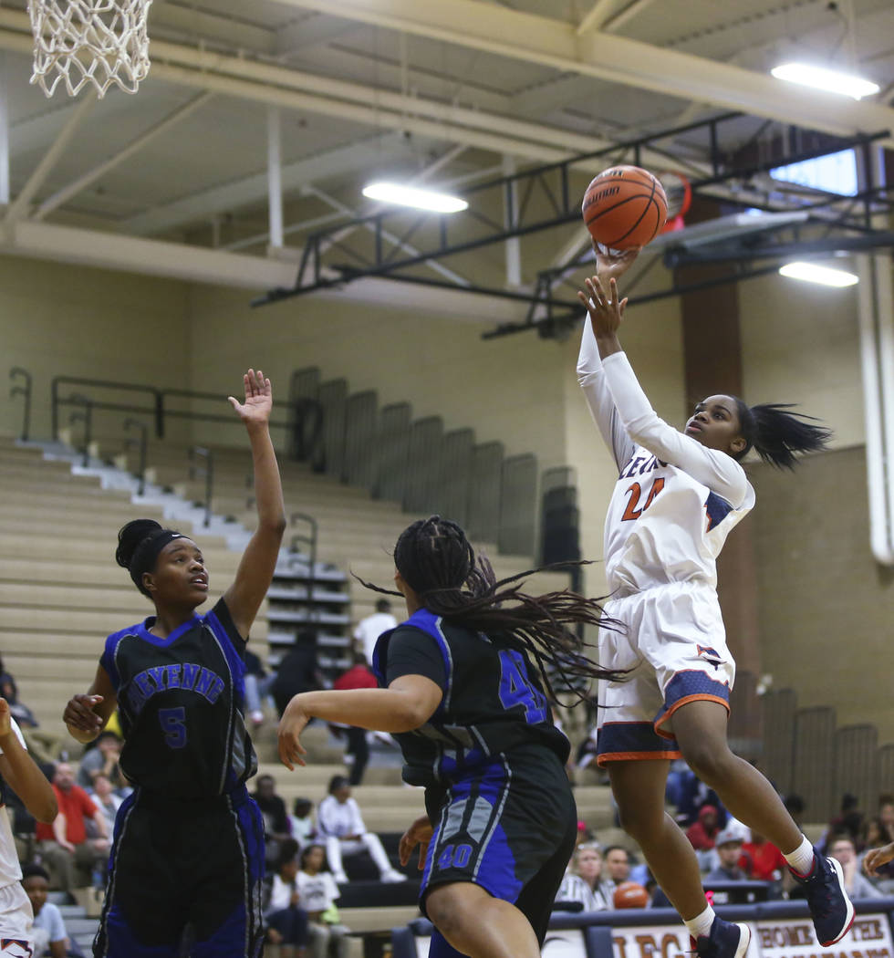 Legacy's Maiah Yearwood (24) shoots over Cheyenne defenders during a basketball game at Legacy High School in Las Vegas on Thursday, Feb. 1, 2018. Chase Stevens Las Vegas Review-Journal @csstevens ...