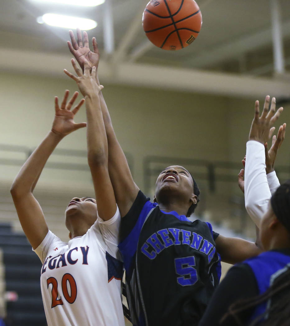 Legacy's Amiya DeSouza (20) and Cheyenne's Shanice Aycox (5) fight for a rebound during a basketball game at Legacy High School in Las Vegas on Thursday, Feb. 1, 2018. Chase Stevens Las Vegas Revi ...