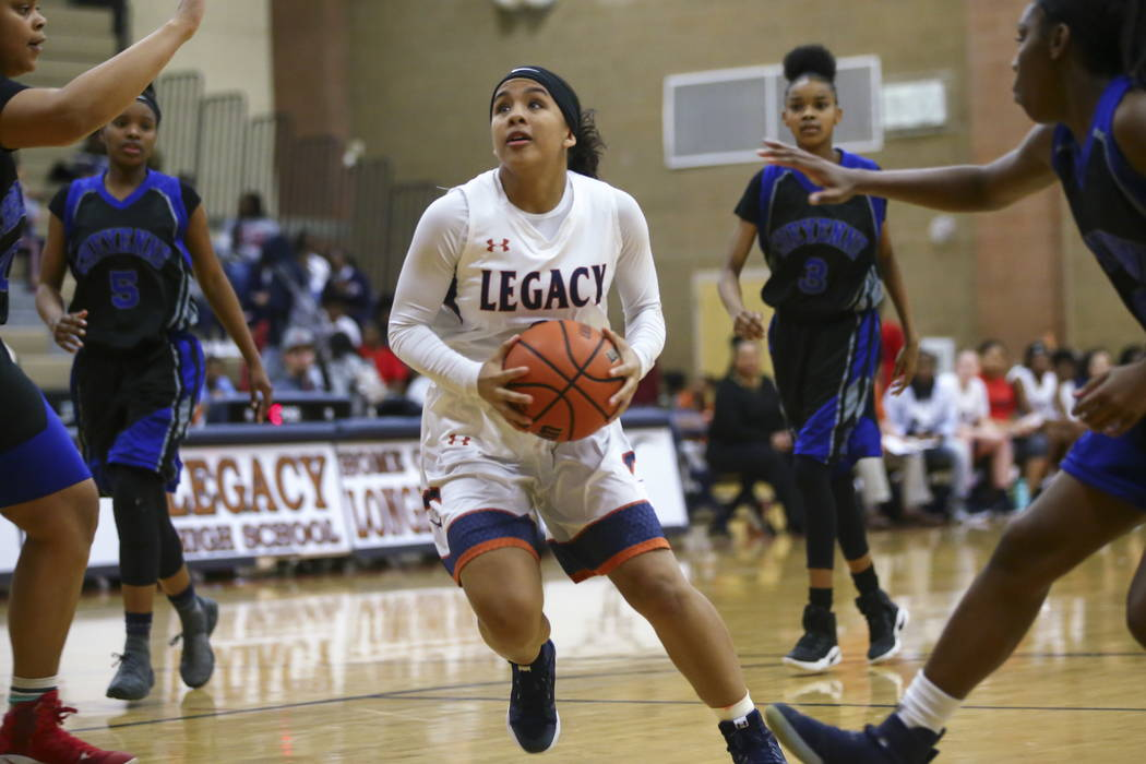 Legacy's Taeha Pankey (3) drives to the basket against Cheyenne during a basketball game at Legacy High School in Las Vegas on Thursday, Feb. 1, 2018. Chase Stevens Las Vegas Review-Journal @csste ...