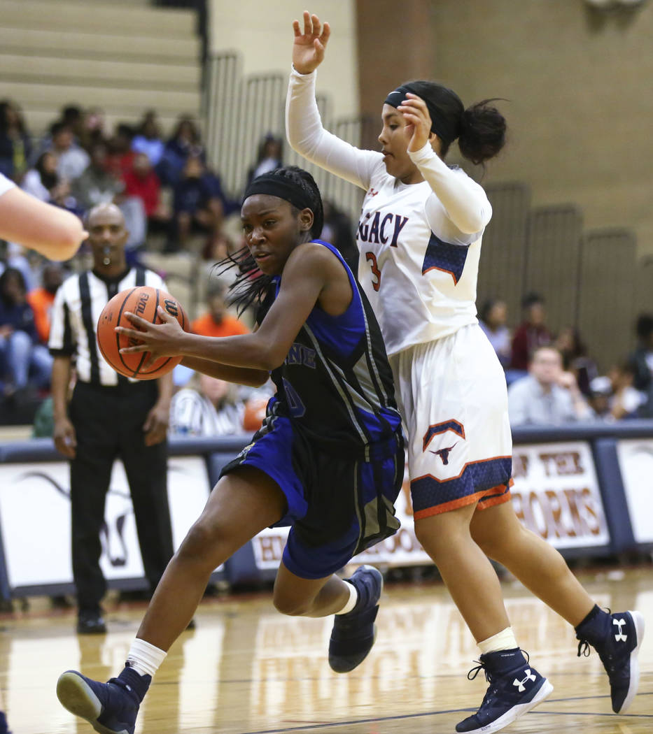 Cheyenne's Almond Slayton (0) drives to the basket against Legacy's Taeha Pankey (3) during a basketball game at Legacy High School in Las Vegas on Thursday, Feb. 1, 2018. Chase Stevens Las Vegas  ...