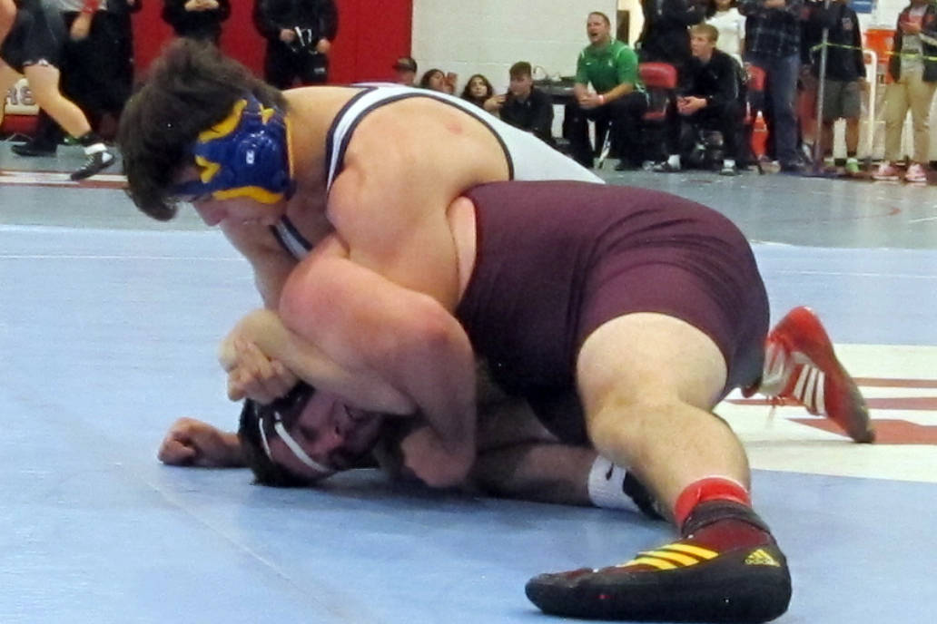 Ryan Vanario of Boulder City, top, grapples with Jeremy Albertson of Pahrump Valley in a quarterfinal match in the 195-pound weight class at the Class 3A Southern Region wrestling tournament at We ...