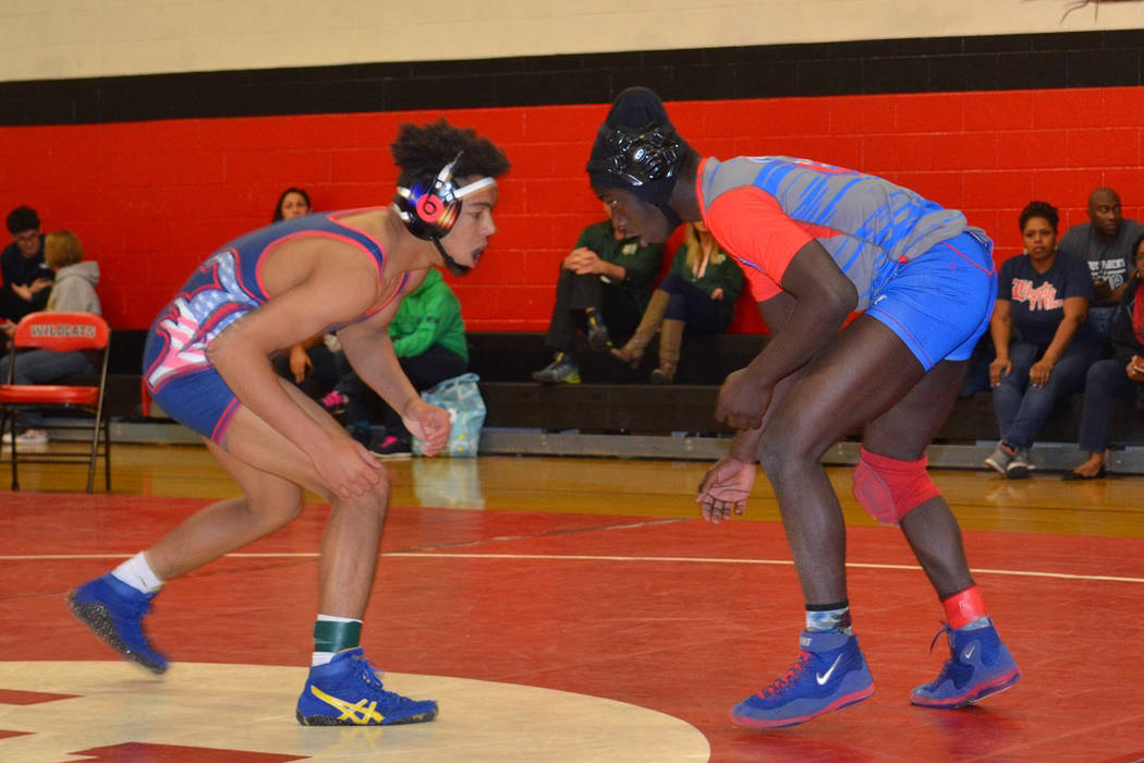 Valley 145-pounder Xzavier Maheia (right) looks to tie up with Liberty's Jayden Rookhuyzen during a quarterfinal match Friday in the Sunrise Region Wrestling Tournament, which concludes today at L ...
