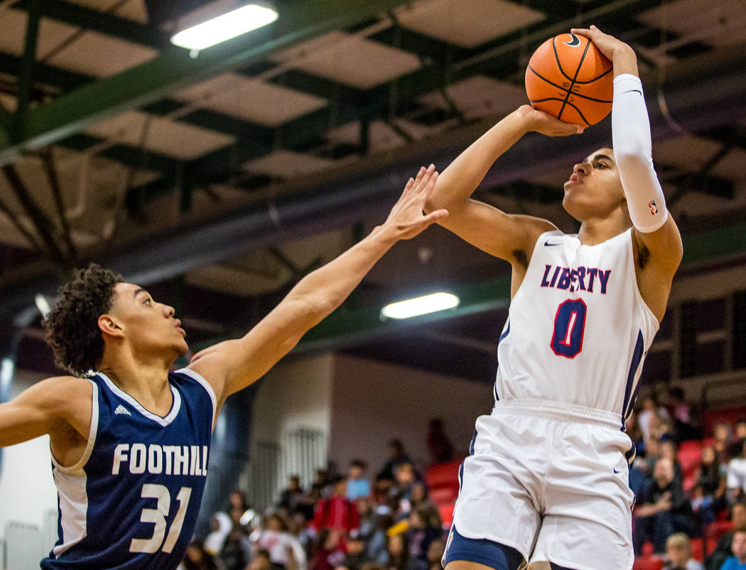 Liberty's Julian Strawther (0) goes up for a shot while Foothill's Marvin Coleman (31) tries to block him at Liberty High School in Henderson on Friday, Feb. 2, 2018. Foothill won 69-65.  Patrick  ...