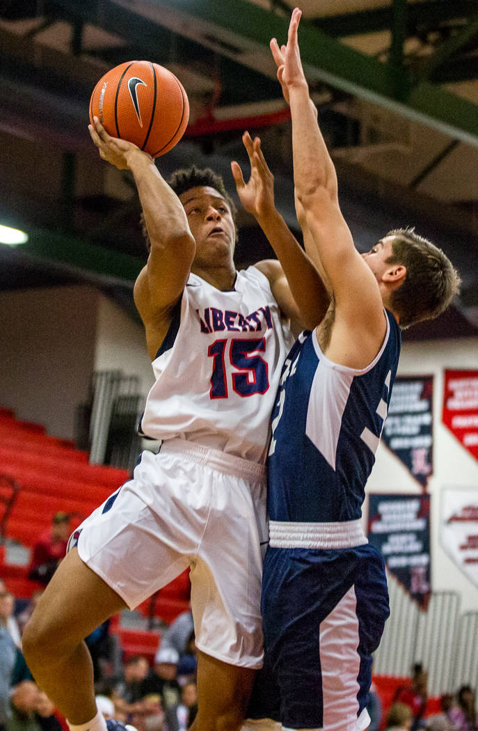 Liberty's Cameron Burist (15) tries to shoot around the defense of Foothill's Dylan Hushaw (32) at Liberty High School in Henderson on Friday, Feb. 2, 2018. Foothill won 69-65.  Patrick Connolly L ...