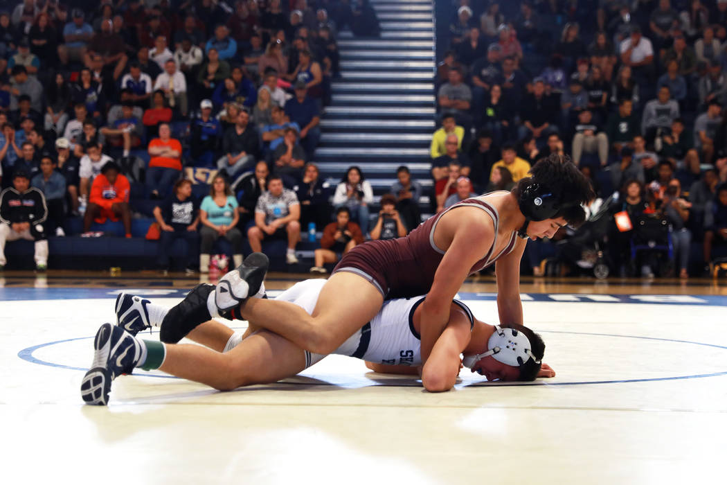 Nathanial Rodriguez, of Cimarron-Memorial High School, pins down Matthew Van Riel, of Shadow Ridge High School, on Saturday during the Sunset Region Wrestling Finals at Centennial High School in L ...