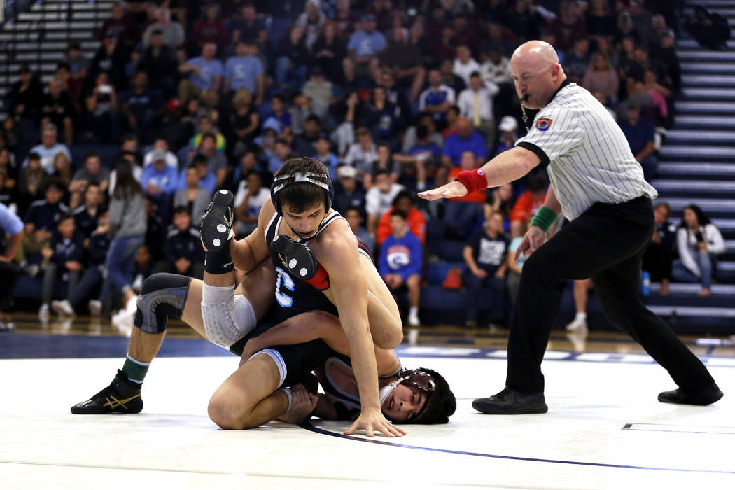 Nico Antuna, of Centennial High School, left, wrestles Daniel Rodriguez, of Cimarron-Memorial High School, on Saturday during the Sunset Region Wrestling Finals at Centennial High School in Las Ve ...