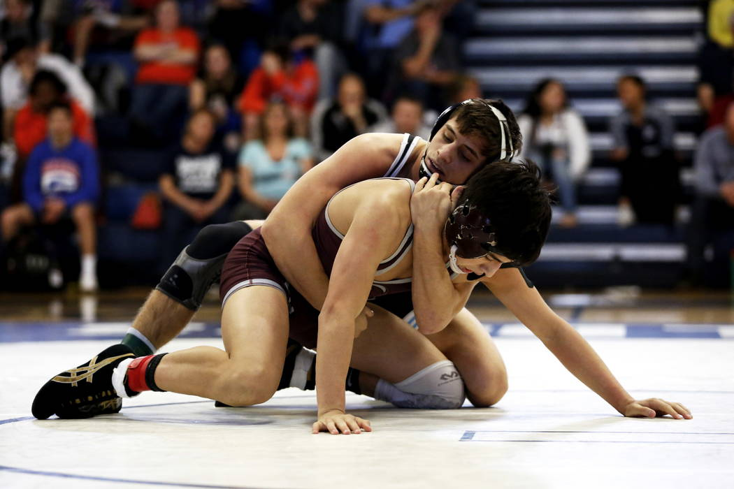 Nico Antuna, of Centennial High School, tries to pin Daniel Rodriguez, of Cimarron-Memorial High School, on Saturday during the Sunset Region Wrestling Finals at Centennial High School in Las Vega ...