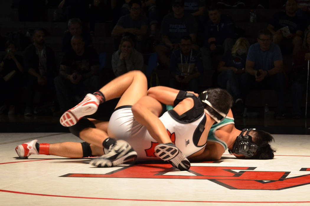 Las Vegas' Antonio Saldate looks to turn Green Valley's David Kalayanaprapruit for back points during their 126-pound championship of the Sunrise Region wrestling meet at Las Vegas High on Saturda ...