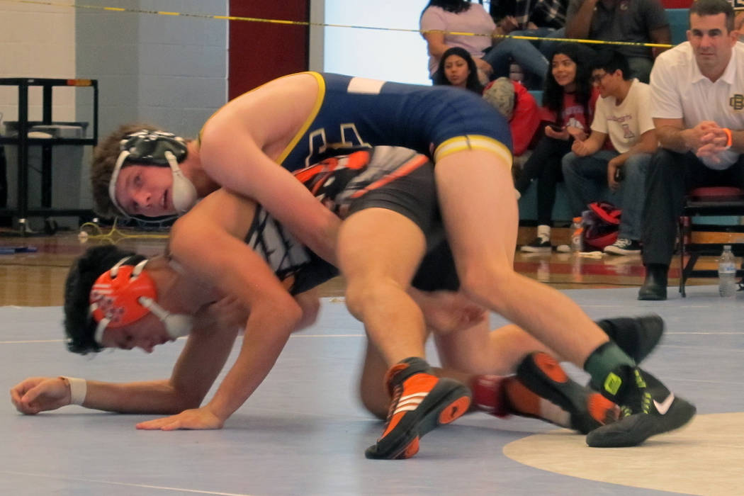 D.J. Reese of Boulder City, top, wrestles Marc Gonzales of Chaparral in the 132-pound championship match at the Class 3A Southern Region wrestling tournament on Saturday, Feb. 3, 2018 at Western H ...