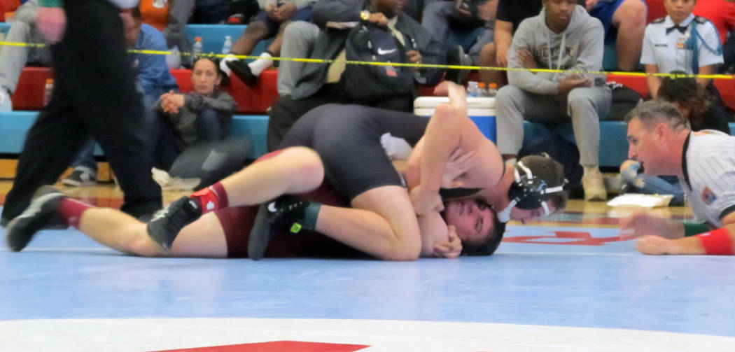 Cresent Crandall of Virgin Valley, top, wrestles Cole Walker of Pahrump Valley in the 182-pound championship match at the Class 3A Southern Region wrestling tournament on Saturday, Feb. 3, 2018 at ...