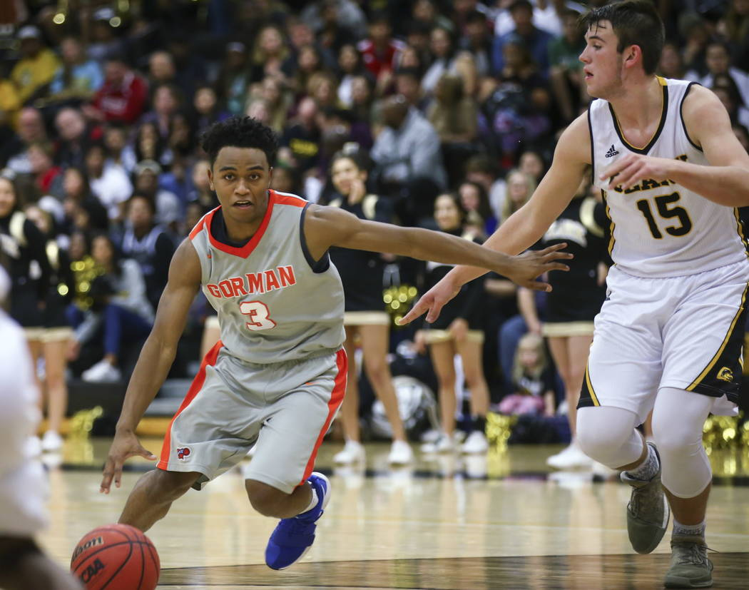 Bishop Gorman's D.J. Howe (3) drives against Clark's James Bridges (15) during a basketball game at Clark High School in Las Vegas on Tuesday, Jan. 30, 2018. Chase Stevens Las Vegas Review-Journal ...