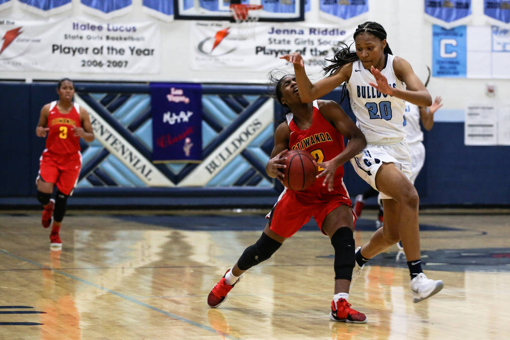 Etiwanda's Aujane Mayes (2) is guarded by Centennial's Taylor Bigby (20) during the second quarter of the Las Vegas Holiday Classic championship basketball game at Centennial High School in Las Ve ...