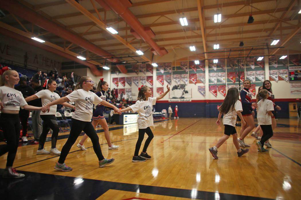 Coronado High School cheerleaders lead young cheerleaders-in-training to perform during halftime at Coronado High School in Henderson, Wednesday, Feb. 7, 2018. Rachel Aston Las Vegas Review-Journa ...