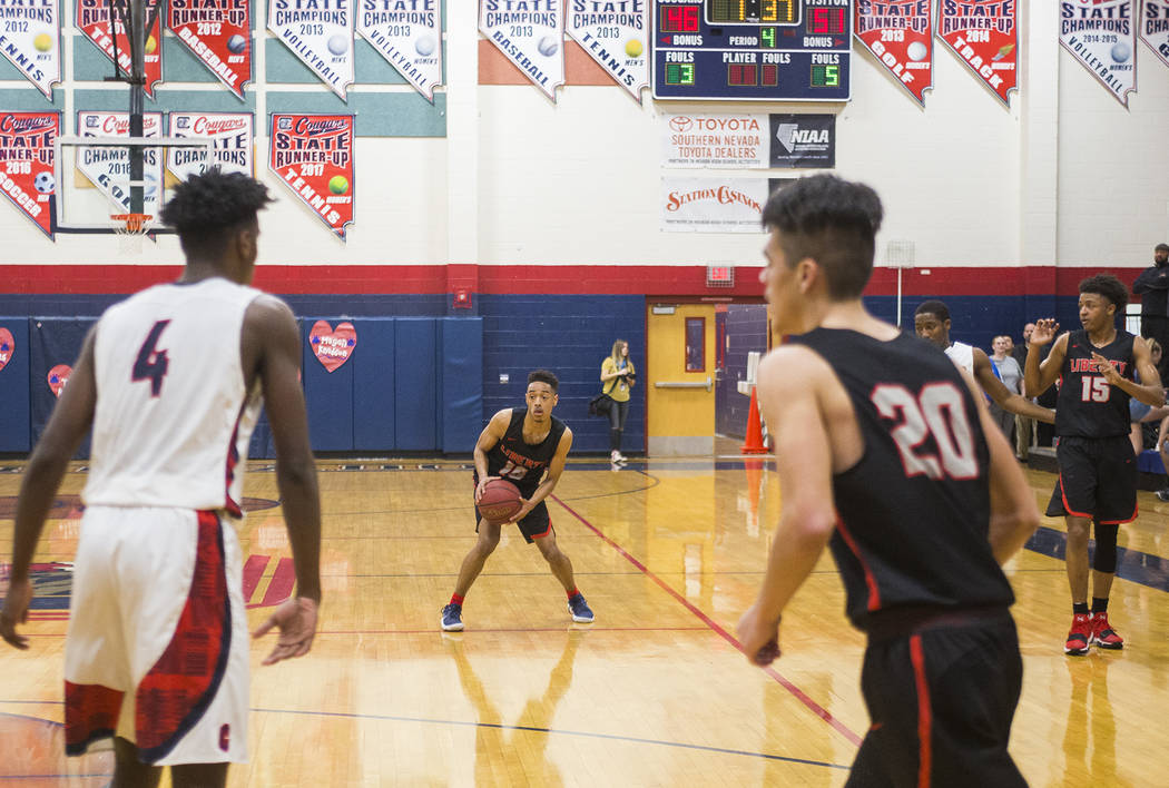 Liberty High School's Jordon Holt (10) prepares to dribble past opponents in a game against Coronado High School at Coronado High School in Henderson, Wednesday, Feb. 7, 2018. Liberty won 69-61. R ...