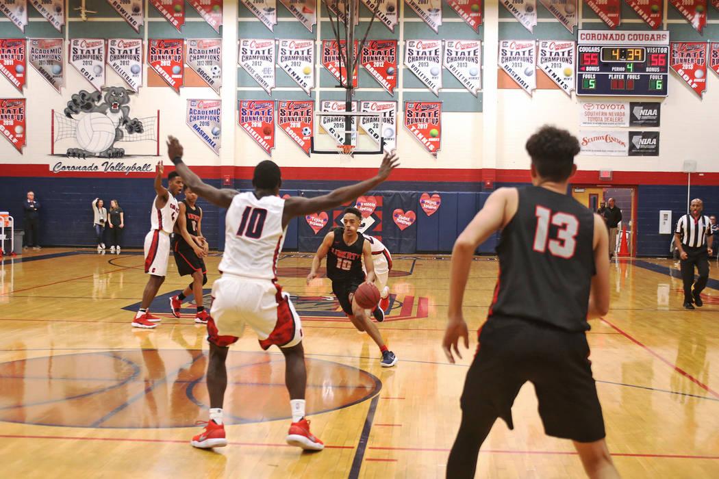 Liberty High School's Jordon Holt (10) prepares to dribble past Coronado High School's Tyrelle Hunt (10) at Coronado High School in Henderson, Wednesday, Feb. 7, 2018. Liberty won 69-61. Rachel As ...