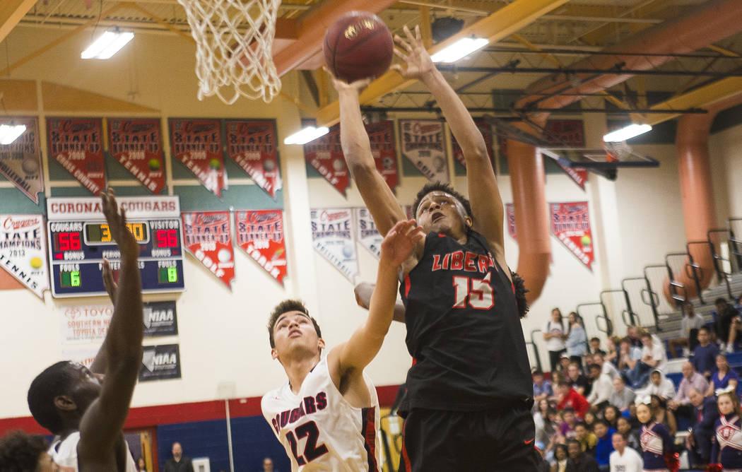 Liberty High School's Cameron Burist (15) attempts a basket against Coronado High School's Patrick Simms (22) at Coronado High School in Henderson, Wednesday, Feb. 7, 2018. Liberty won 69-61. Rach ...