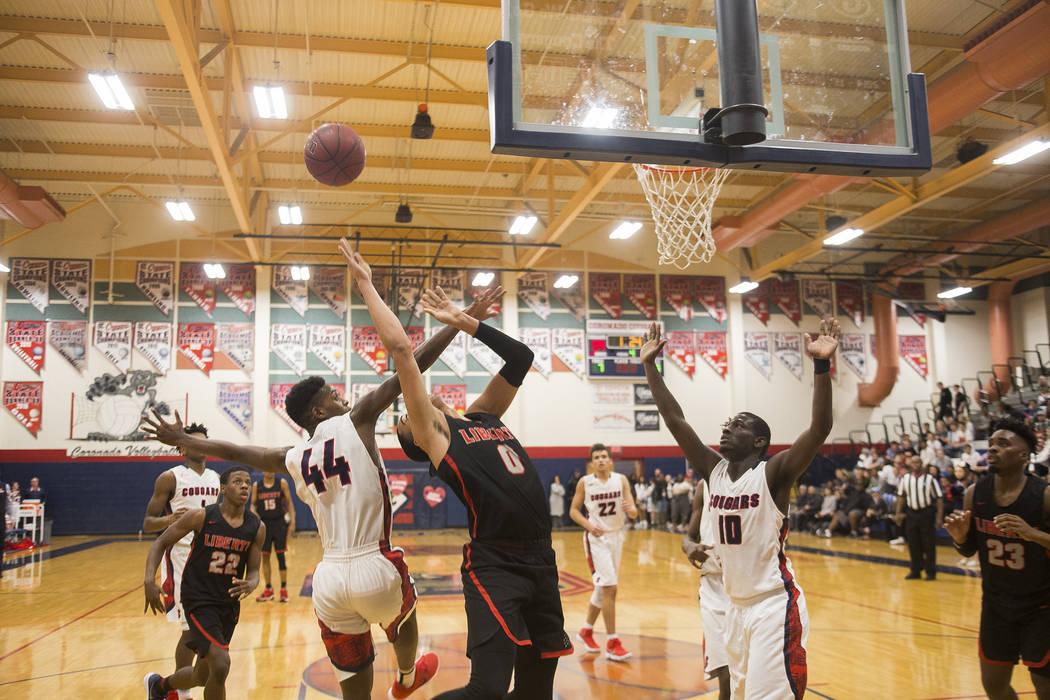 Liberty High School's Julian Stawther (0) attempts a basket against Coronado High School's Taieem Comeaux (44) and Tyrelle Hunt (10) at Coronado High School in Henderson, Wednesday, Feb. 7, 2018.  ...