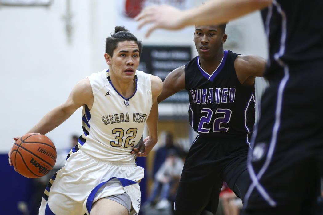 Sierra Vista's Maka Ellis (32) drives against Durango's Vernell Watts (22) during a basketball game at Sierra Vista High School in Las Vegas on Thursday, Feb. 8, 2018. Chase Stevens Las Vegas Revi ...