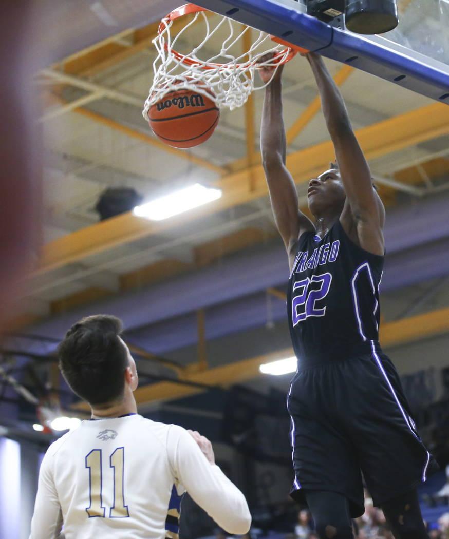 Durango's Vernell Watts (22) dunks over Sierra Vista's David Howard (11) during a basketball game at Sierra Vista High School in Las Vegas on Thursday, Feb. 8, 2018. Chase Stevens Las Vegas Review ...