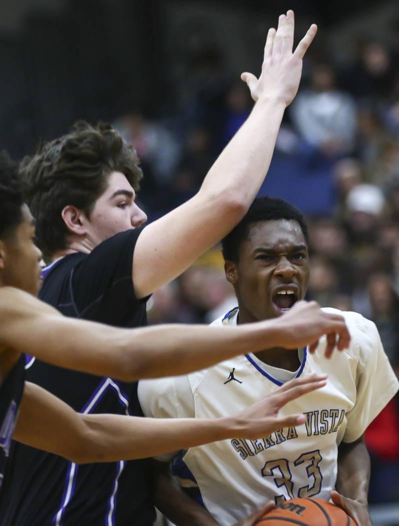 Sierra Vista's Jalen McFadden (33) drives to the basket against Durango's Jovan Lubura, left, during a basketball game at Sierra Vista High School in Las Vegas on Thursday, Feb. 8, 2018. Chase Ste ...