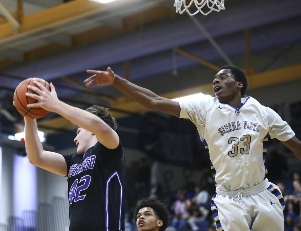 Durango's Jovan Lubura (42) gets a rebound over Sierra Vista's Jalen McFadden (33) during a basketball game at Sierra Vista High School in Las Vegas on Thursday, Feb. 8, 2018. Chase Stevens Las Ve ...