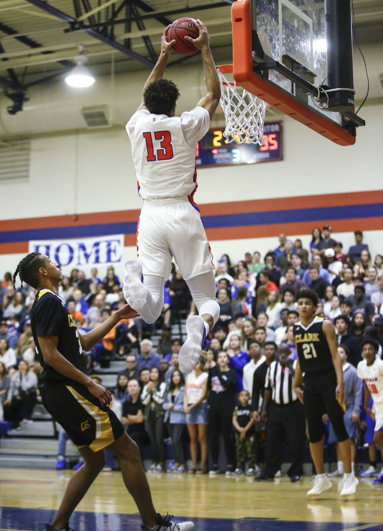 Bishop Gorman's Zim Agu (13) goes up to complete an alley-oop against Clark during a basketball game at Bishop Gorman High School in Las Vegas on Friday, Feb. 9, 2018. Chase Stevens Las Vegas Revi ...