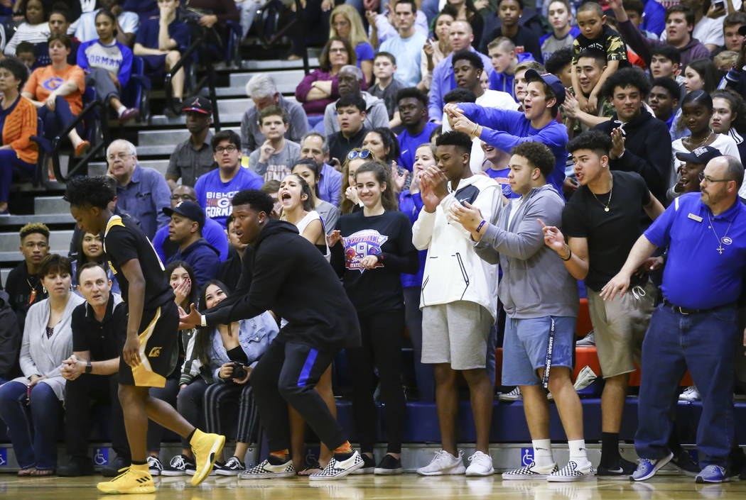 Bishop Gorman fans react after Clark's Joel Burney, left, failed to save a ball going out of bounds during a basketball game at Bishop Gorman High School in Las Vegas on Friday, Feb. 9, 2018. Chas ...