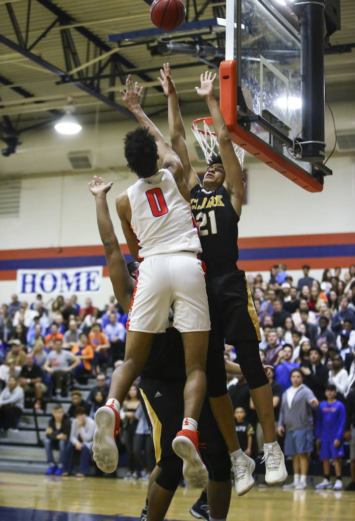 Bishop Gorman's Isaiah Cottrell (0) sends the ball over Clark's Jalen Hill (21) during a basketball game at Bishop Gorman High School in Las Vegas on Friday, Feb. 9, 2018. Chase Stevens Las Vegas  ...