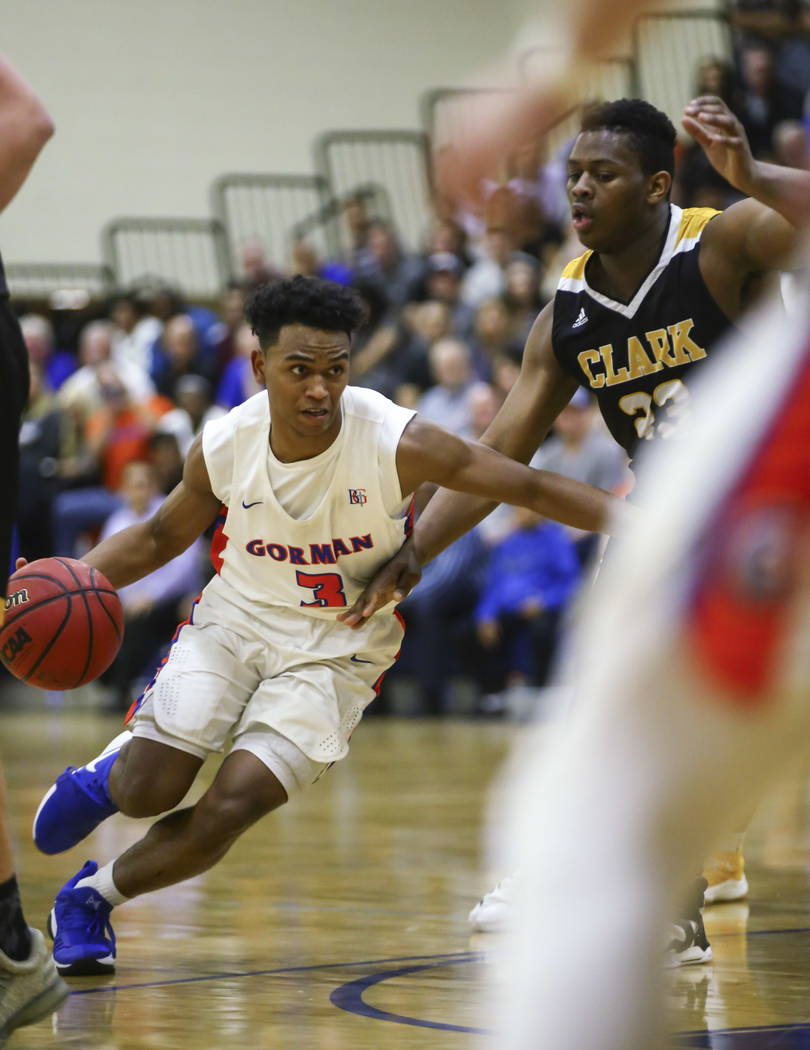 Bishop Gorman's D.J. Howe (3) drives against Clark's Antwon Jackson (23) during a basketball game at Bishop Gorman High School in Las Vegas on Friday, Feb. 9, 2018. Chase Stevens Las Vegas Review- ...