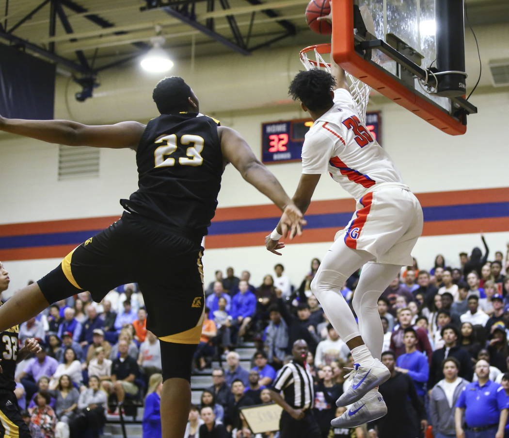 Bishop Gorman's Jamal Bey (35) attempts a dunk past Clark's Antwon Jackson (23) during a basketball game at Bishop Gorman High School in Las Vegas on Friday, Feb. 9, 2018. Chase Stevens Las Vegas  ...