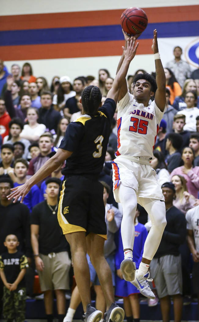 Bishop Gorman's Jamal Bey (35) shoots over Clark's Greg Foster (3) during a basketball game at Bishop Gorman High School in Las Vegas on Friday, Feb. 9, 2018. Chase Stevens Las Vegas Review-Journa ...