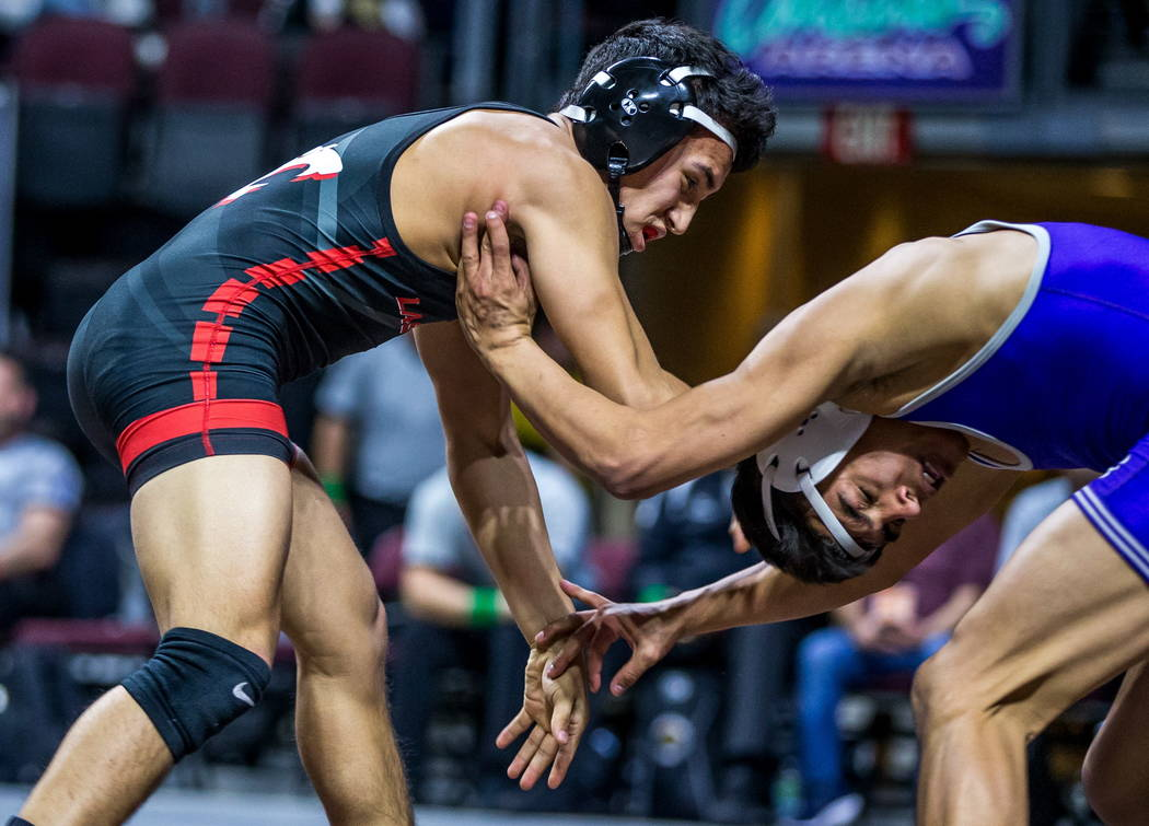 Antonio Saldate of Las Vegas, left, and Jacob Ruiz of Spanish Springs wrestle in the 4A 120 pounds weight class during the NIAA State Championships at The Orleans in Las Vegas on Friday, Feb. 9, 2 ...