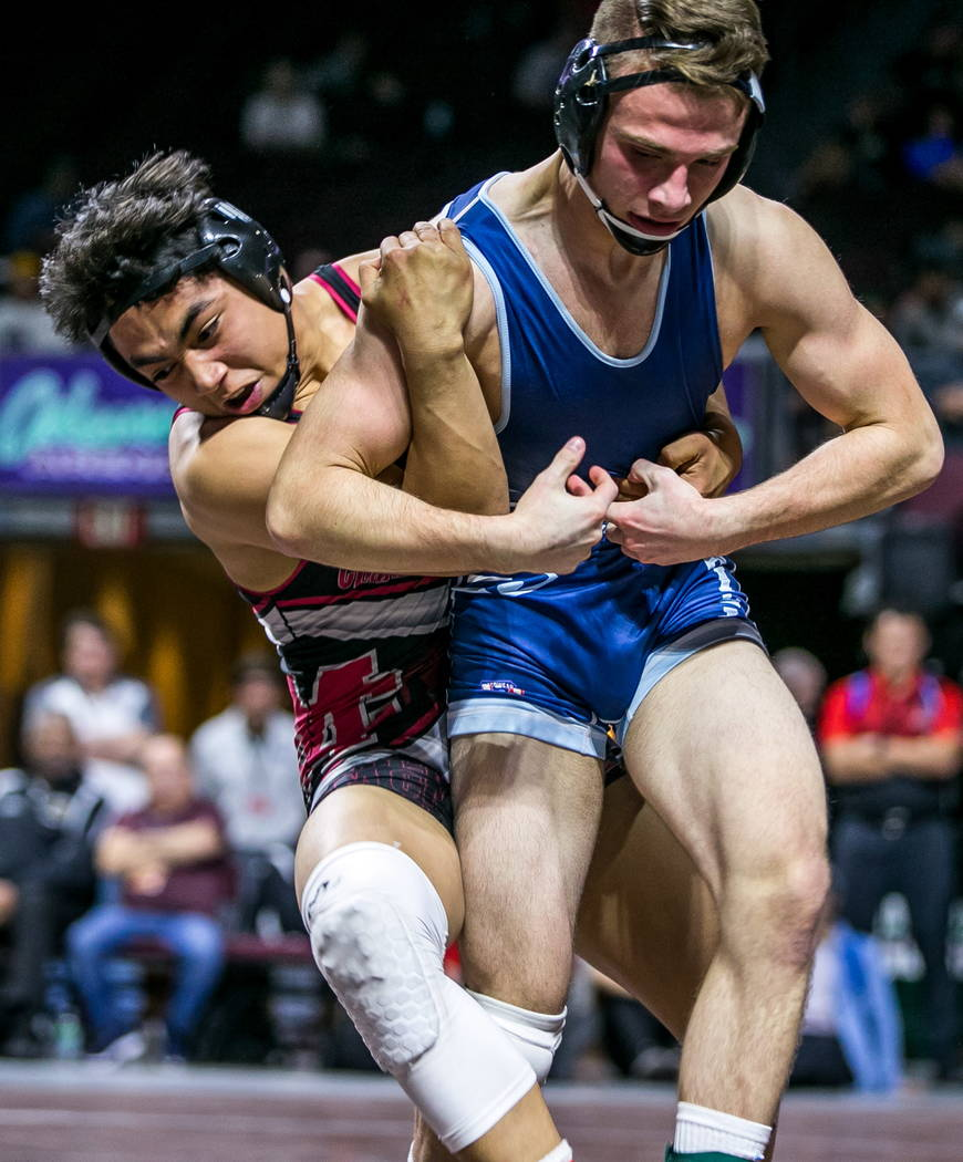 Amado Castellon of Cimarron-Memorial, left, tries to take down Wyatt English of Foothill while wrestling in the 4A 145 pounds weight class during NIAA State Championships at The Orleans in Las Veg ...