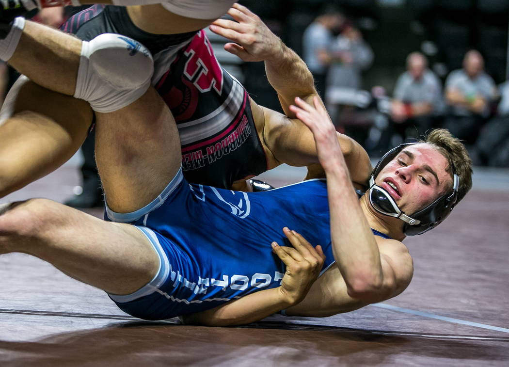 Amado Castellon of Cimarron-Memorial, top, tries to take down Wyatt English of Foothill while wrestling in the 4A 145 pounds weight class during NIAA State Championships at The Orleans in Las Vega ...