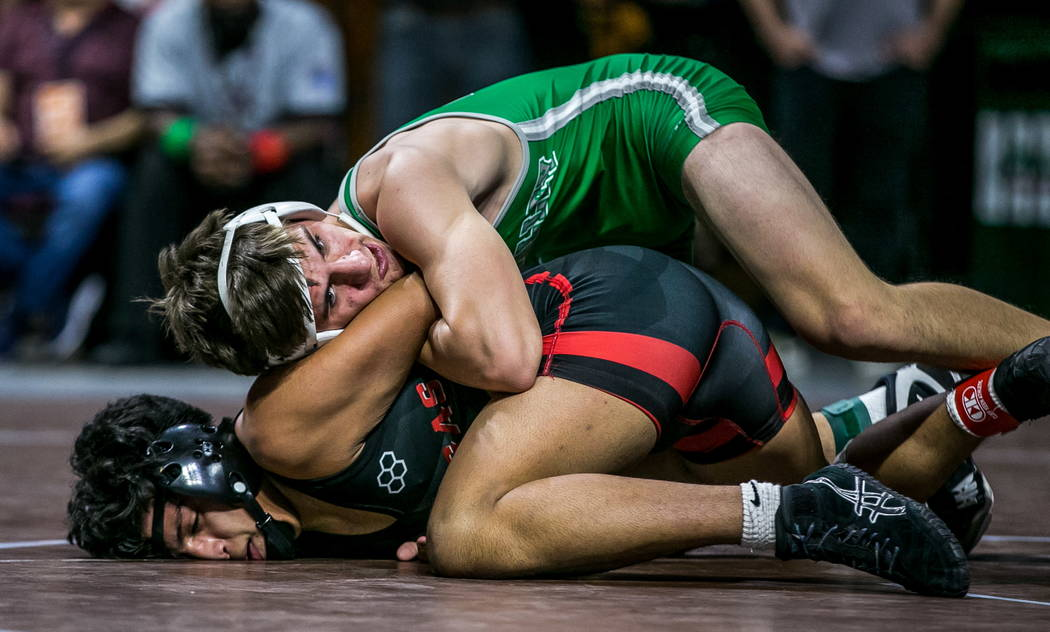Justus Scott of Green Valley, top, and Jakob Alvarado of Las Vegas wrestle in the 4A 152 pound weight class during the NIAA State Championships at The Orleans in Las Vegas on Friday, Feb. 9, 2018. ...