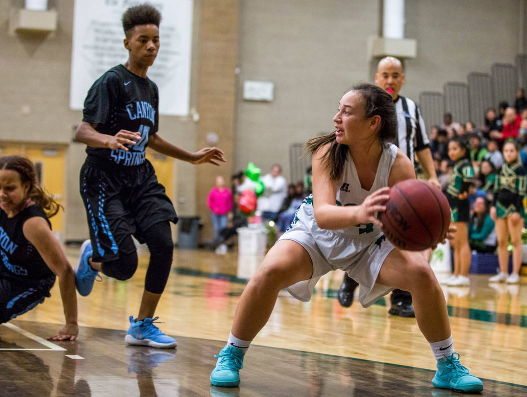 Rancho's Kekai States (3) tries to keep the ball away from Canyon Springs' Kayla Johnson (10) at Rancho High School in Las Vegas on Tuesday, Feb. 6, 2018. Canyon Springs won 58-38.  Patrick Connol ...