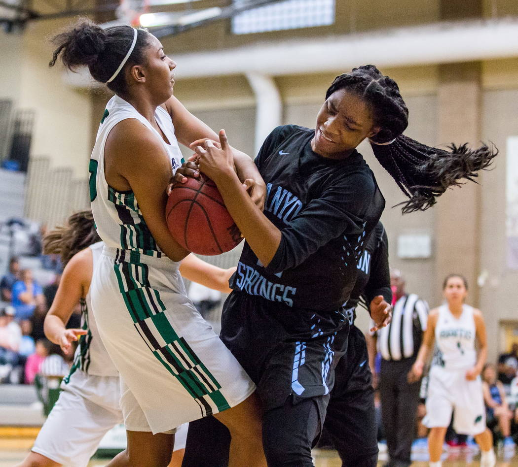 Canyon Springs' Brooklyn Knox (42) and Rancho's Taylor DeGourville (42) grapple over the ball at Rancho High School in Las Vegas on Tuesday, Feb. 6, 2018. Canyon Springs won 58-38.  Patrick Connol ...