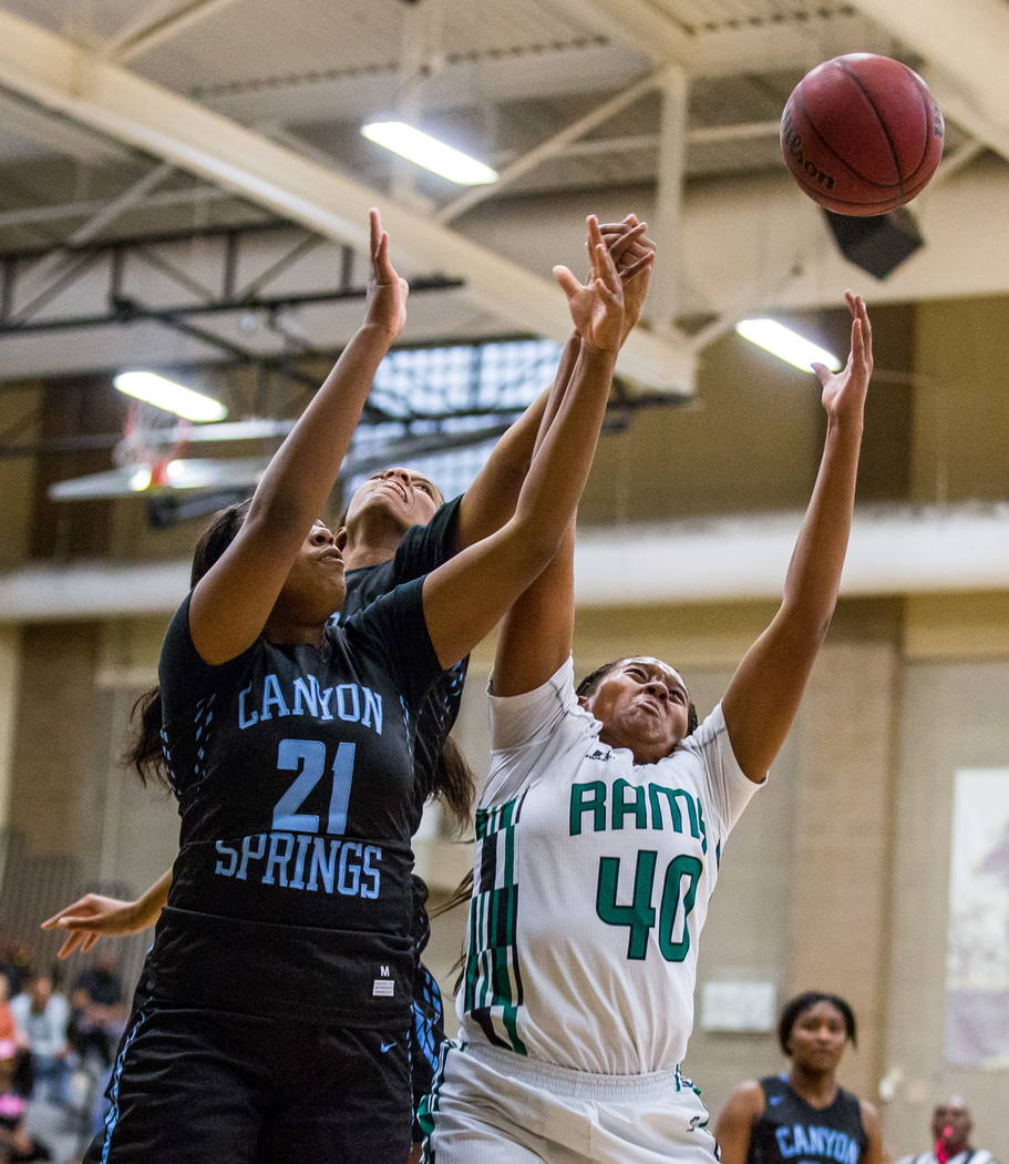 Rancho's Kristal Sullivan (40) reaches for the ball while Canyon Springs players Diamond Coleman (21) and Shania Pollord (40) at Rancho High School in Las Vegas on Tuesday, Feb. 6, 2018. Canyon Sp ...