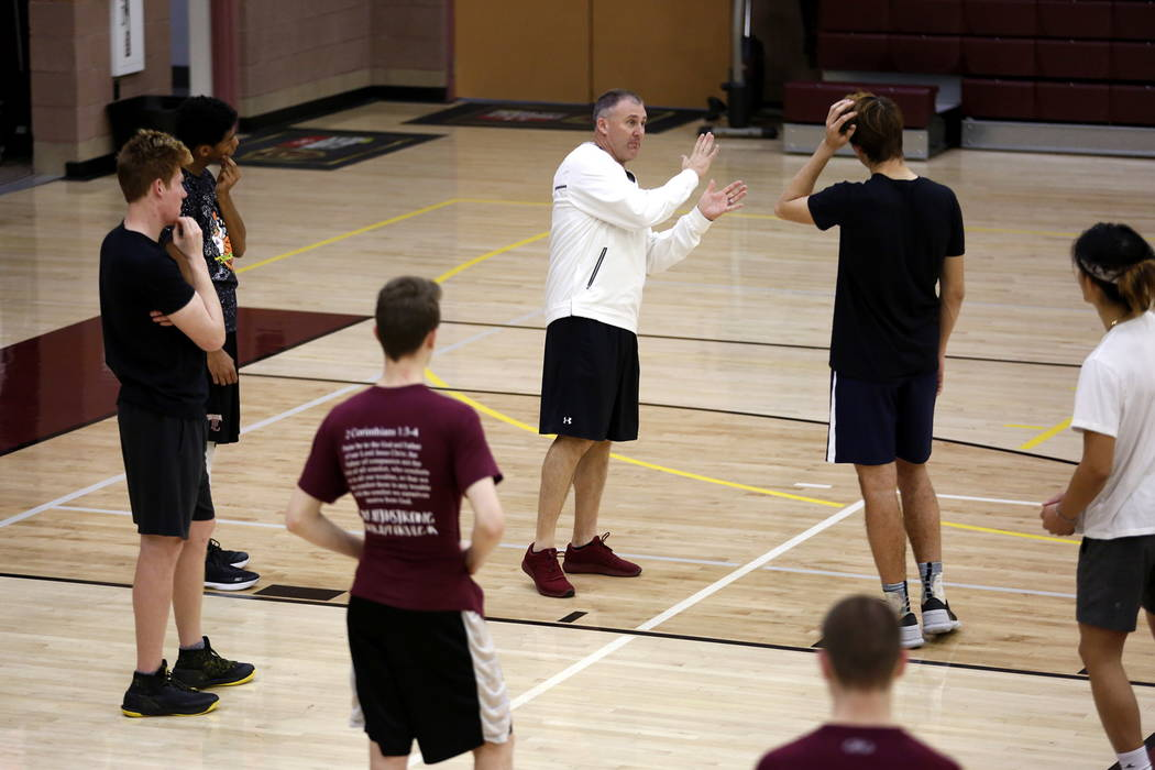 Coach Bret Walter trains the Faith Lutheran Basketball Team, which won the Northwest League title, in the gym at Faith Lutheran High School in Las Vegas on Saturday, Feb. 10, 2018. Andrea Cornejo  ...