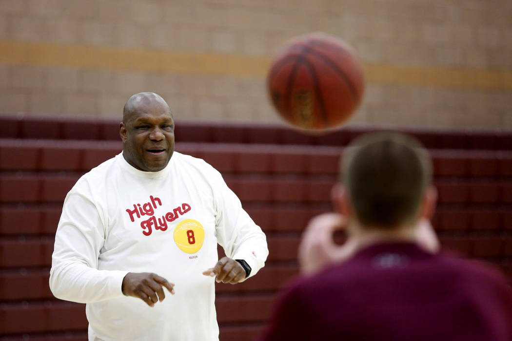 Assistant Coach Mike Brown helps trains the Faith Lutheran Basketball Team, which won the Northwest League title, in the gym at Faith Lutheran High School in Las Vegas on Saturday, Feb. 10, 2018.  ...