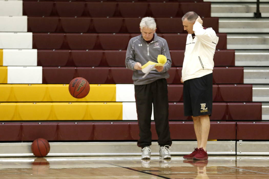 Coach Bret Walter talks to assistant coach Tom Powers while training the Faith Lutheran Basketball Team, which won the Northwest League title, in the gym at Faith Lutheran High School in Las Vegas ...