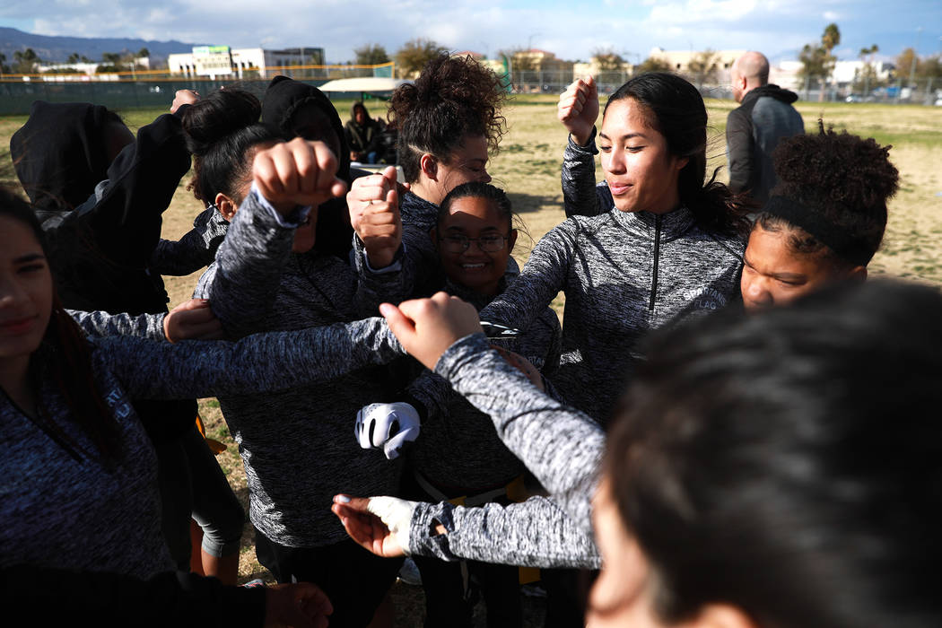 Tiarra Del Rosario, one of the best flag football players in the state, huddles with the team at the end of practice at Cimarron-Memorial High School in Las Vegas on Monday, Feb. 12, 2018. Andrea  ...