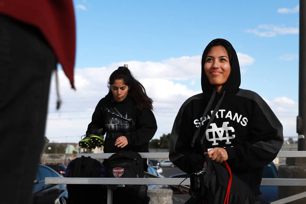 Tiarra Del Rosario, one of the best flag football players in the state, talks to a friend after practice at Cimarron-Memorial High School in Las Vegas on Monday, Feb. 12, 2018. Andrea Cornejo Las  ...